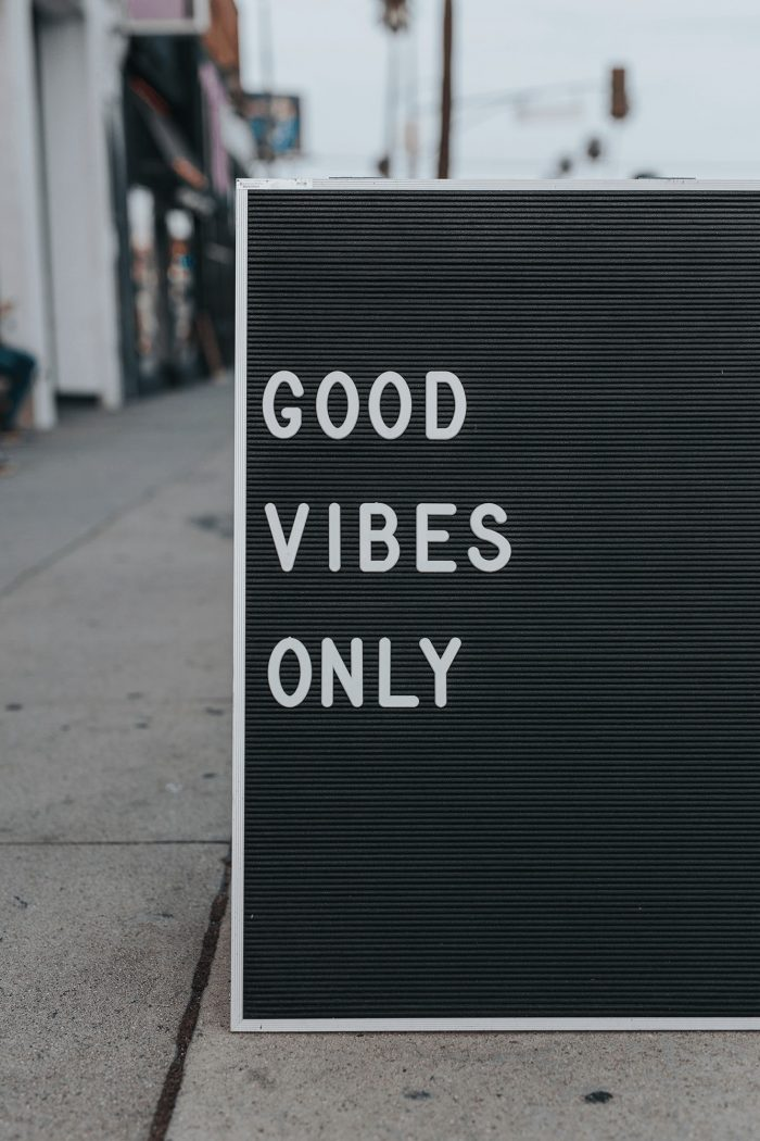 motivation for support staff - shows a team noticeboard with phrase 'good vibes only'